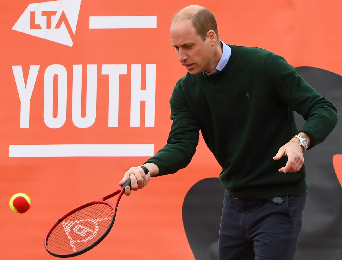 Britain's Prince William, Duke of Cambridge,, plays tennis games with local scho
