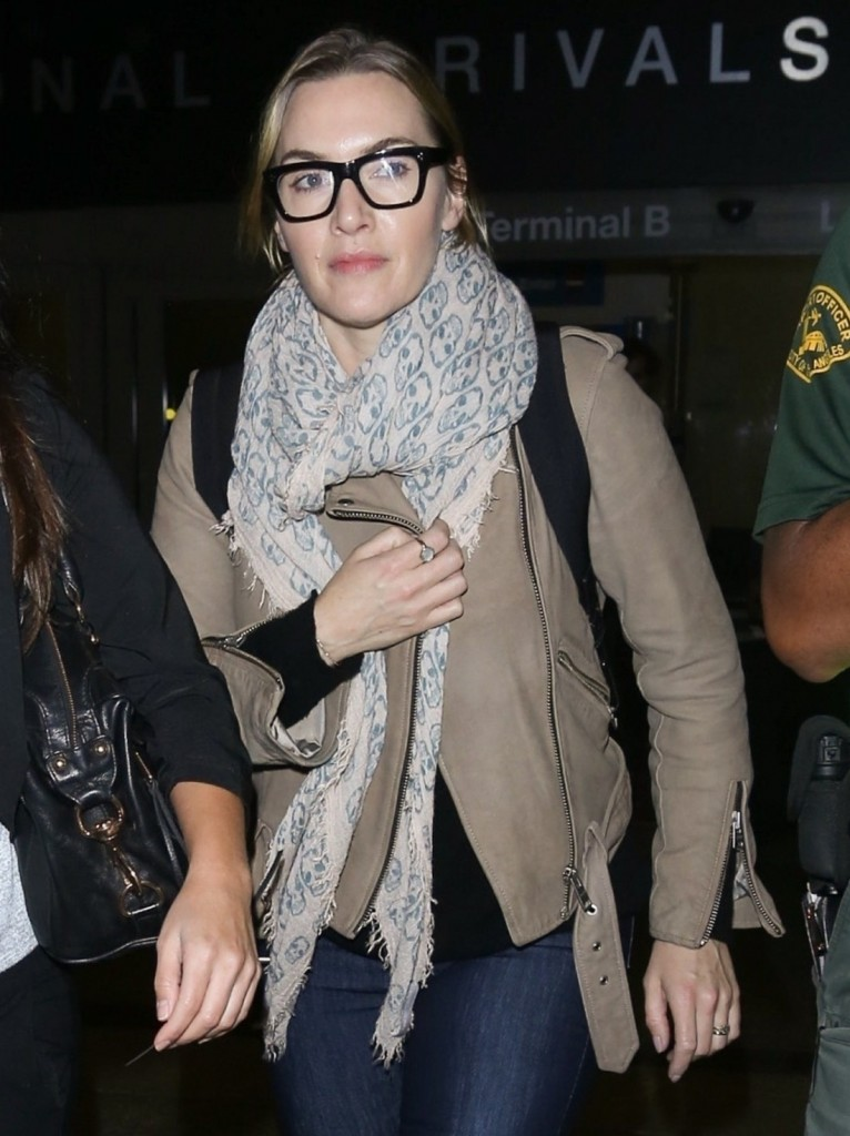 Kate Winslet keeps bundled up as she touches down at LAX