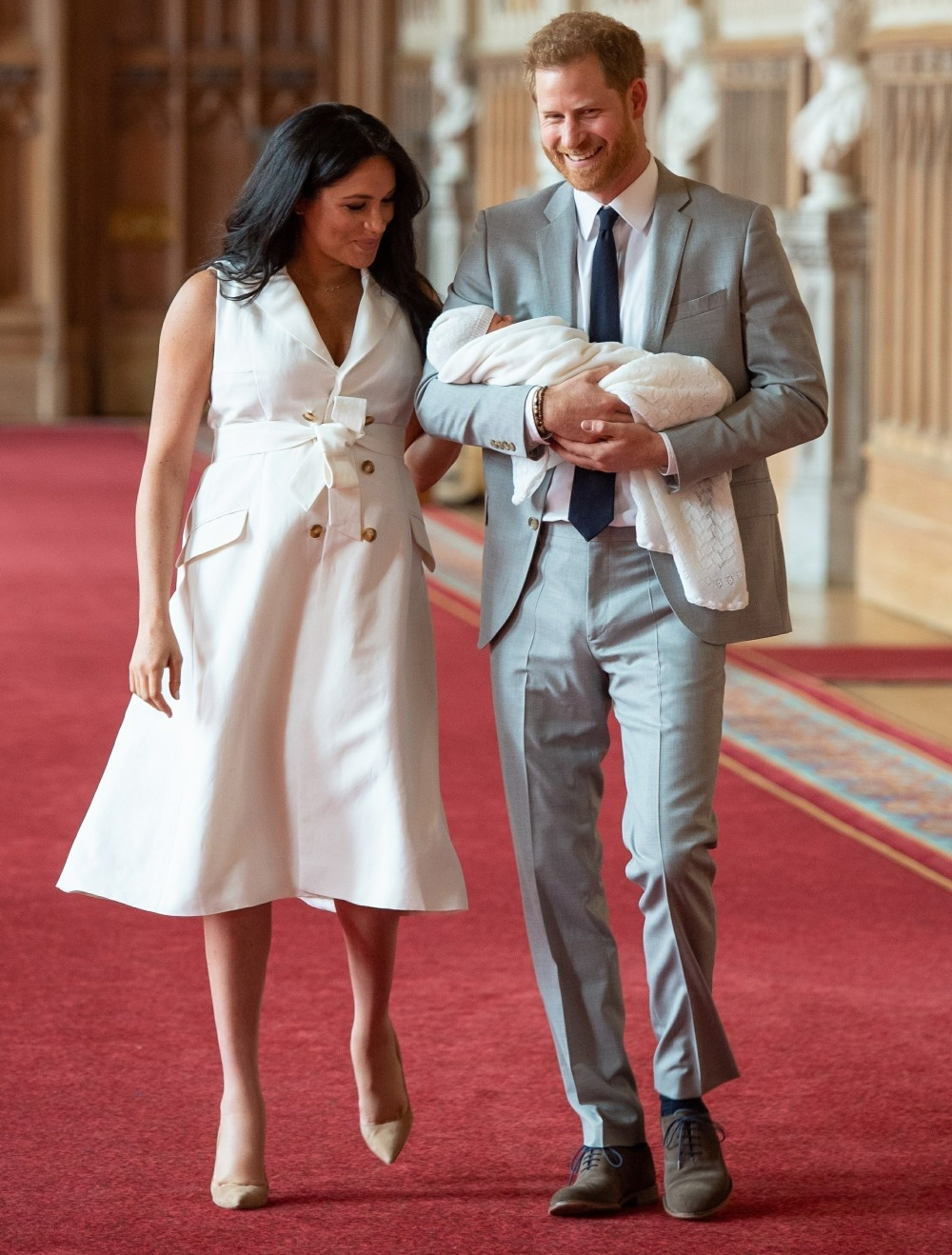 Prince Harry, Duke of Sussex and Meghan, Duchess of Sussex, pose with their newborn son