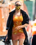 Irina Shayk does it again! Model steps out in a stunning orange mini dress in NYC!