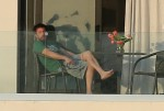 Ben Affleck looks right at home as he steps out on the balcony to smoke a cigarette wearing a Green Monstah while enjoying his Miami getaway with Jennifer Lopez
