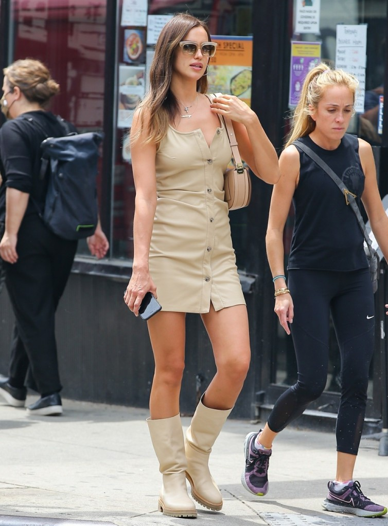 Sexy Irina Shayk wears a neutral-colored dress but has a BOLD walk in NYC