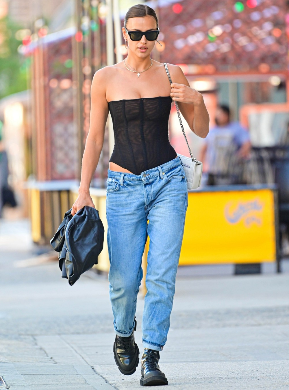 Irina Shayk puts her model hips on display wearing a sexy laced bodysuit
