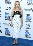 Actress Scarlett Johansson wearing a Balmain dress and Hanut Singh earrings arrives at the 2020 Film...