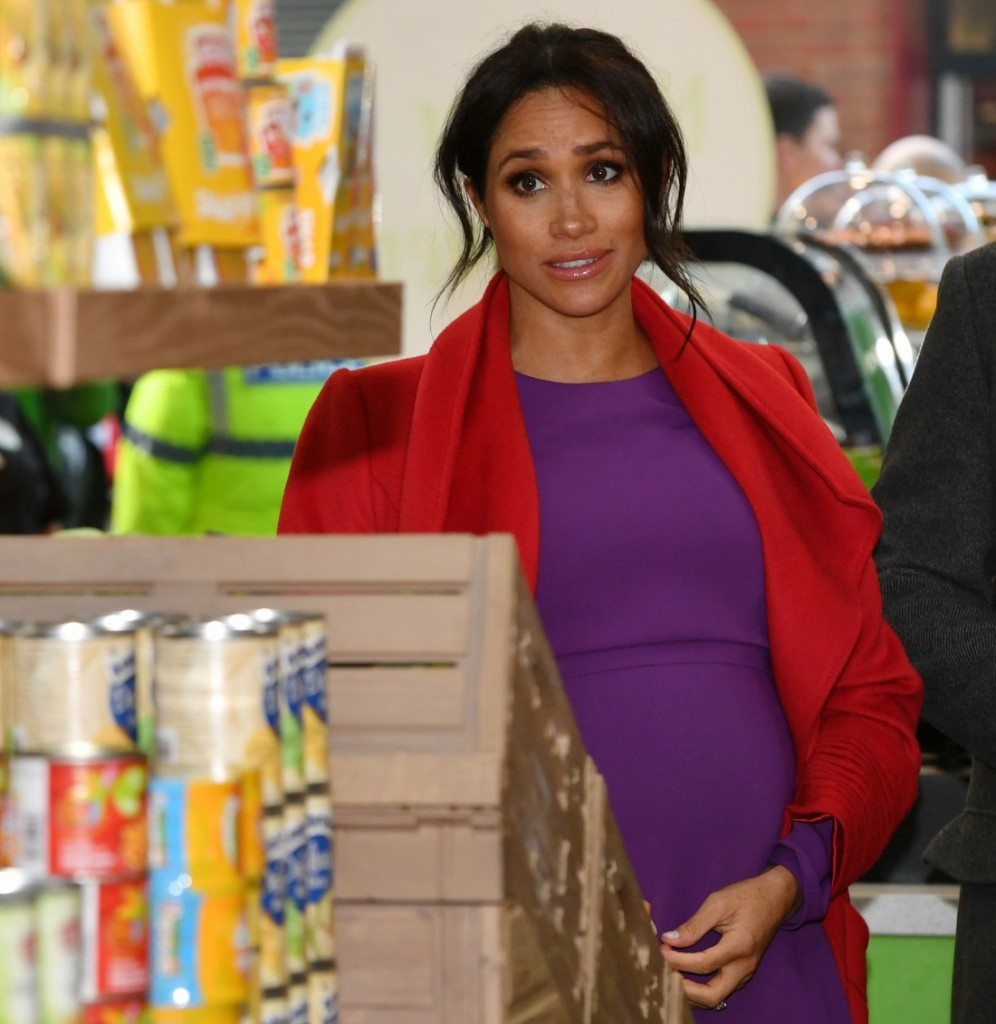 BIRKENHEAD, ENGLAND - JANUARY 14:  Meghan, Duchess of Sussex arrives to official