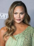 Model Chrissy Teigen wearing a Georges Hobeika dress arrives at the 2019 Baby2Baby Gala held at 3Labs on November 9, 2019 in Culver City, Los Angeles, California, United States.