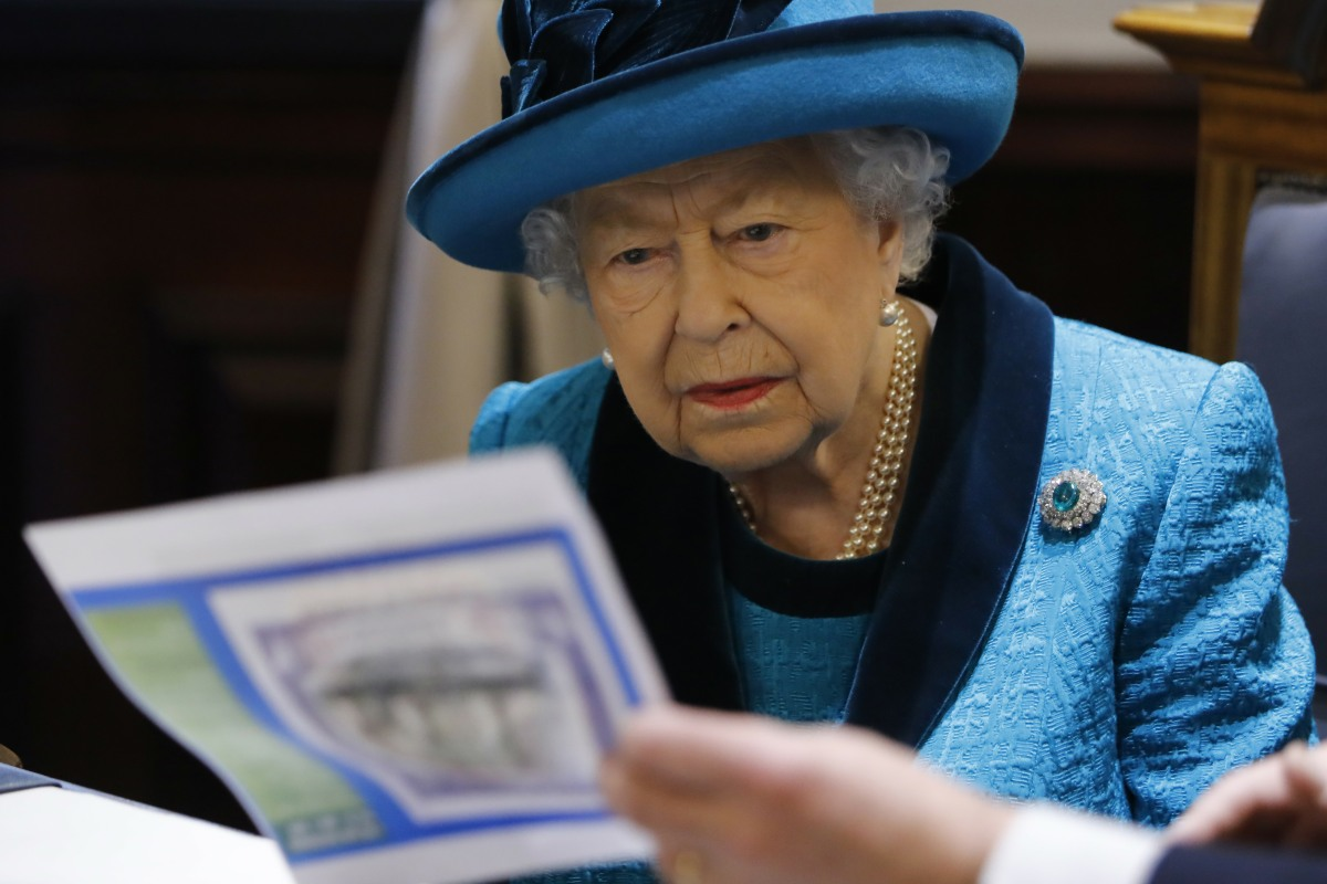 Britain's Queen Elizabeth II is shown documents as she visits the new headquarters of the Royal Philatelic society in London on November 26, 2019.