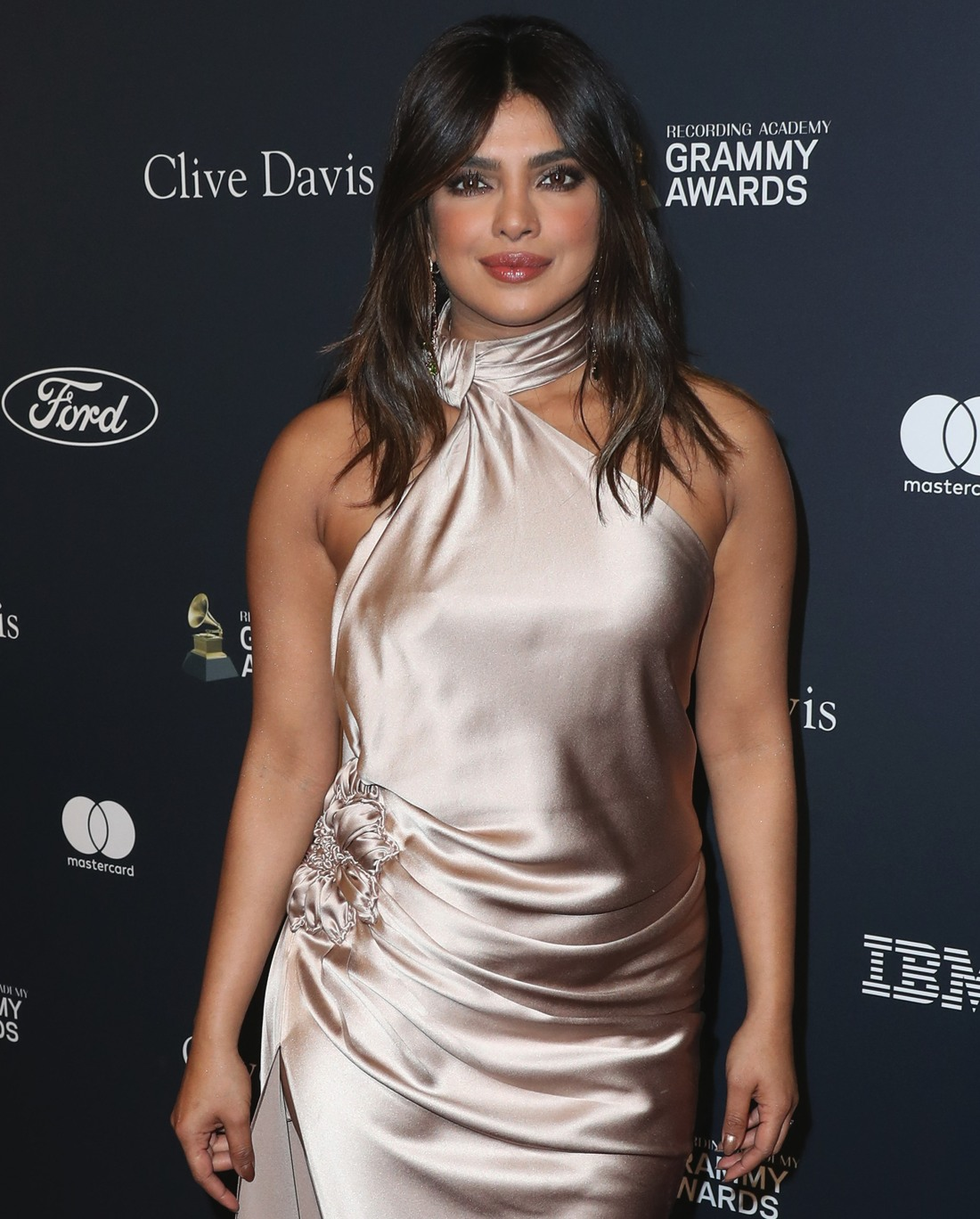 Actress Priyanka Chopra wearing a Nicolas Jebran gown, Bvlgari jewelry, and Stuart Weitzman shoes while carrying a Jimmy Choo clutch arrives at The Recording Academy And Clive Davis' 2020 Pre-GRAMMY Gala held at The Beverly Hilton Hotel on January 25, 202