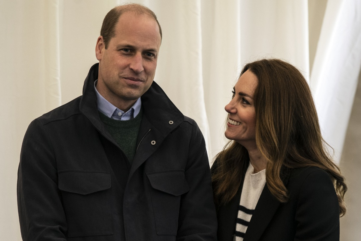 Britain's Catherine, Duchess of Cambridge and Britain's Prince William, Duke of Cambridge meet students as they visit the University of St Andrews in St Andrews on May 26, 2021.