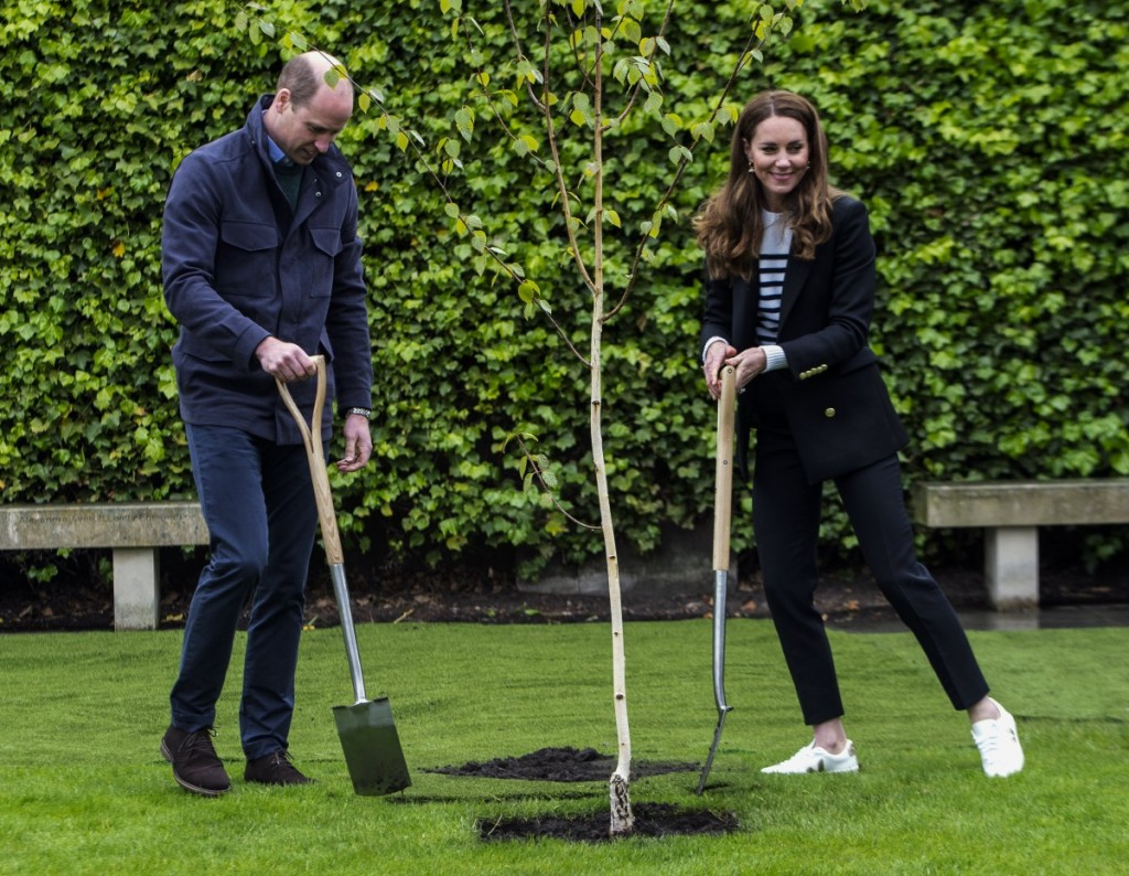 Britain's Catherine, Duchess of Cambridge and Britain's Prince William, Duke of Cambridge, take part in a tree planting ceremony as they visit the University of St Andrews in St Andrews on May 26, 2021.