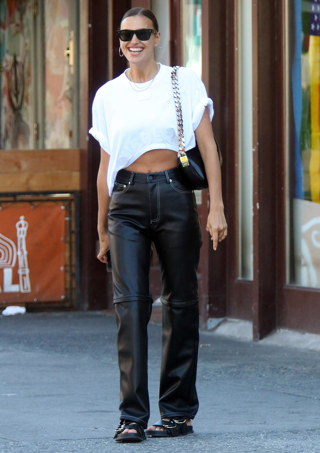 Irina Shayk serves hot model waist and bright smile while out in NYC