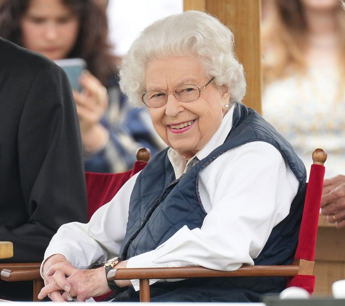 Queen Elizabeth II watches her horses compete on the second day of the Royal Windsor Horse Show