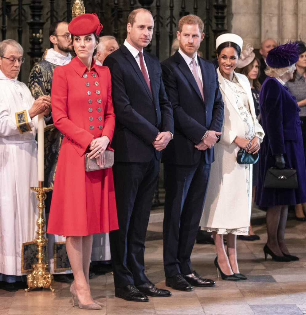 The Duke and duchess of Cambridge stand with the duke and Duchess of Sussex at W