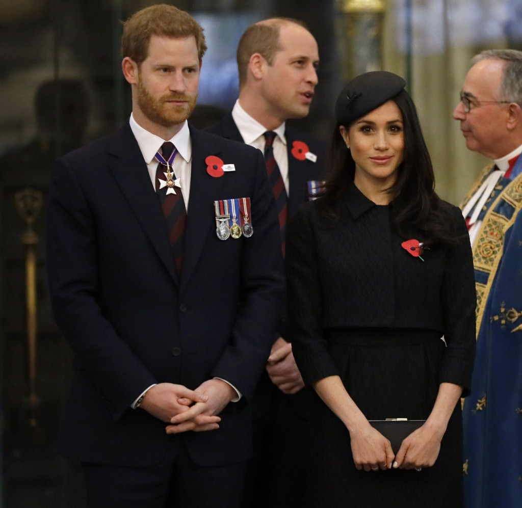 Britain's Prince William, Prince Harry, left, and Meghan Markle arrive to attend a Service of Thanksgiving and Commemoration on ANZAC Day at Westminster Abbey in London, Wednesday, April 25, 2018.