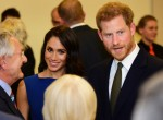 The Duke and Duchess of Sussex meet guests during the interval of a commemorativ