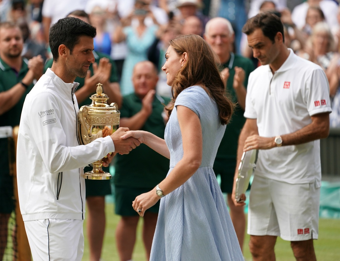 Catherine, Duchess of Cambridge, presents the Wimbledon Men's Singles trophy to Novak Djokovic after his victory over Roger Federer.London, United Kingdom - Sunday July 14th, 2019.