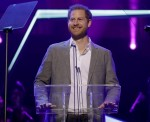 Britain's Prince Harry gives a speech on stage before announcing the winners of the Health and Wellbeing category at the inaugural OnSide Awards at the Royal Albert Hall in London, Sunday, Nov. 17, 2019. OnSide is a charity whose purpose is to create stat