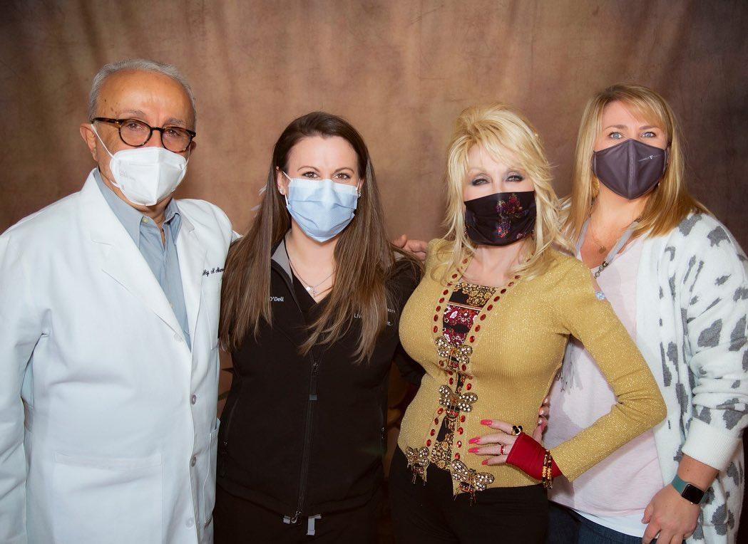 Dolly with the team who developed the Moderna vaccine, via Instagram