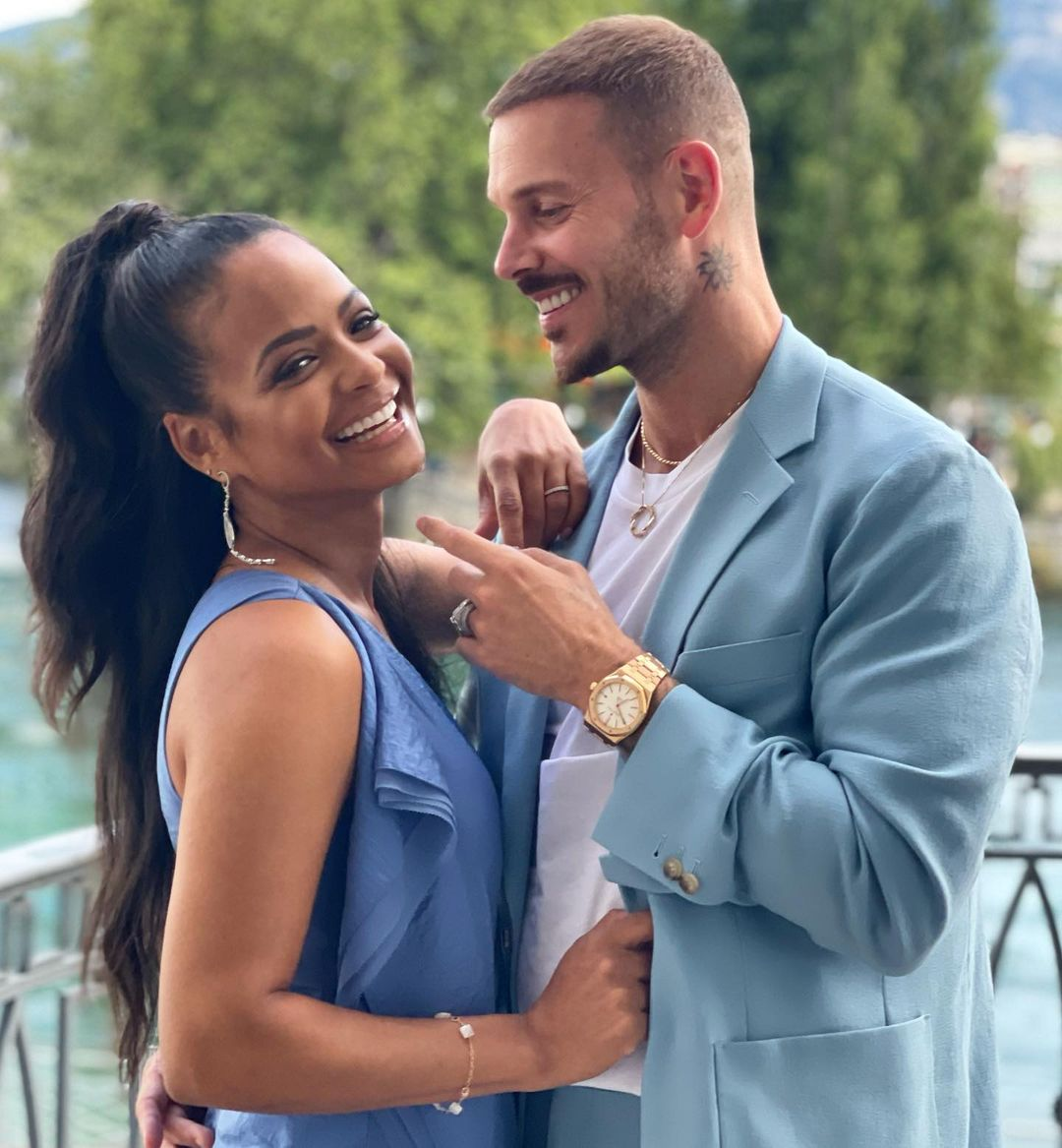 Christina Milian with her boyfriend, Matt, she is smiling at the camera and he is looking at her adoringly
