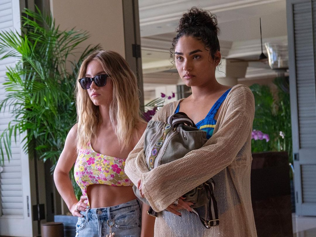 Still from White Lotus of Olivia and Paula looking annoyed and defiant