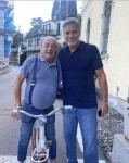 George Clooney walking the streets of Laglio, near his Italian home on Lake Como, to give his support to the owners of bars and restaurants who have been affected by severe weather.