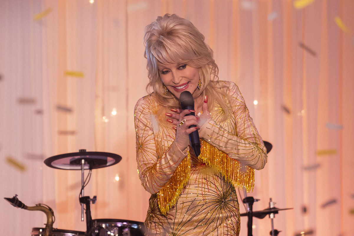 Dolly performing in a still from Dolly Parton's Heartstrings on Netflix