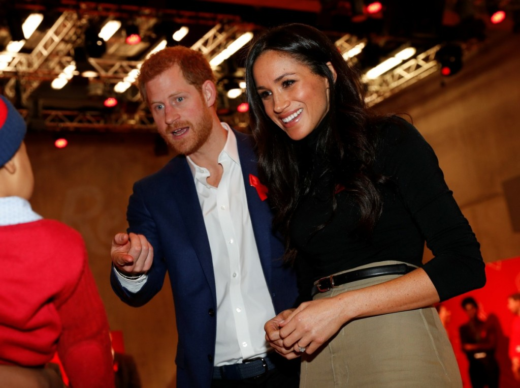 Britain's Prince Harry and his fiancee US actress Meghan Markle greet a well-wisher as they tour the Terrence Higgins Trust World AIDS Day charity fair at Nottingham Contemporary in Nottingham, central England, on December 1, 2017.  Prince Harry and Megh