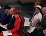 Britain's Kate, Duchess of Cambridge, foreground centre, sits with Prince Willia