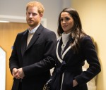 Britain's Prince Harry (L) and his fiancee US actress Meghan Markle (R) visit Nechells Wellbeing Centre to join Coach Core apprentices taking part in a training masterclass in Birmingham, central England on March 8, 2018.  Prince Harry and Meghan Markle