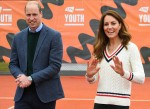 Britain's Prince William, Duke of Cambridge (L) and Britain's Catherine, Duchess