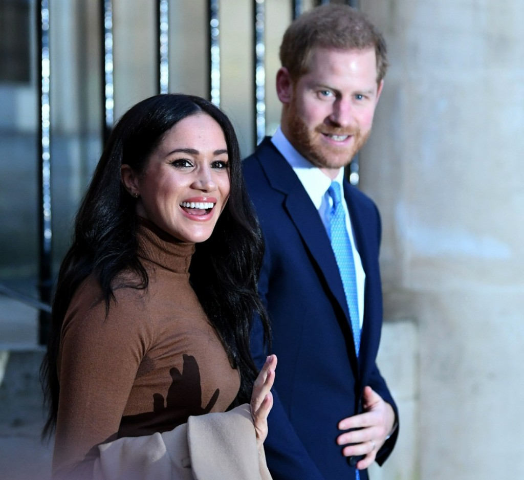 Britain's Prince Harry, Duke of Sussex and Meghan, Duchess of Sussex reacts as they leave after her visit to Canada House in thanks for the warm Canadian hospitality and support they received during their recent stay in Canada, in London on January 7, 2020