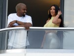 Kanye West and Kim Kardashian pack on the PDA at their new condo in Miami