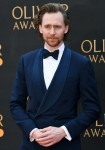 Tom Hiddleston attends the Olivier Awards in London