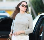 Angelina Jolie arrives curbside for a flight at Paris Airport