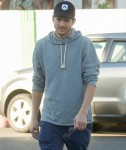 Ashton Kutcher runs errands in Los Angeles keeping it casual in a hoodie and cap