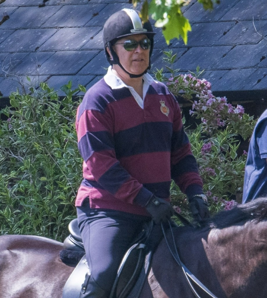 Prince Andrew riding his horse in Windsor accompanied by a groom