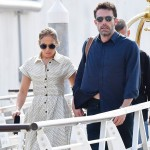 Ben Affleck and Jennifer Lopez look happy as they are seen hand in hand departing from Venice airport