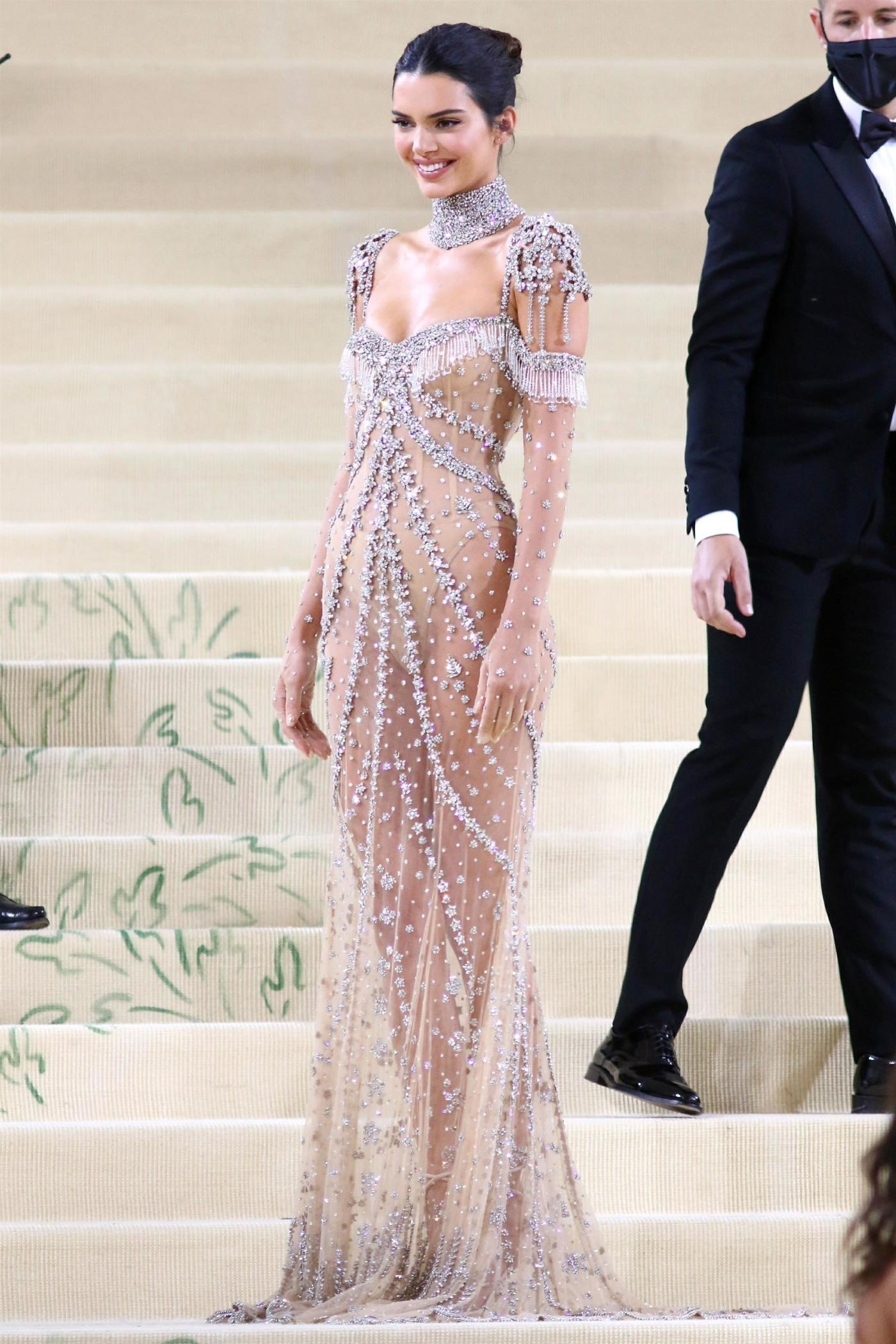 Kim Kardashian and Kendall Jenner attend the Met Gala