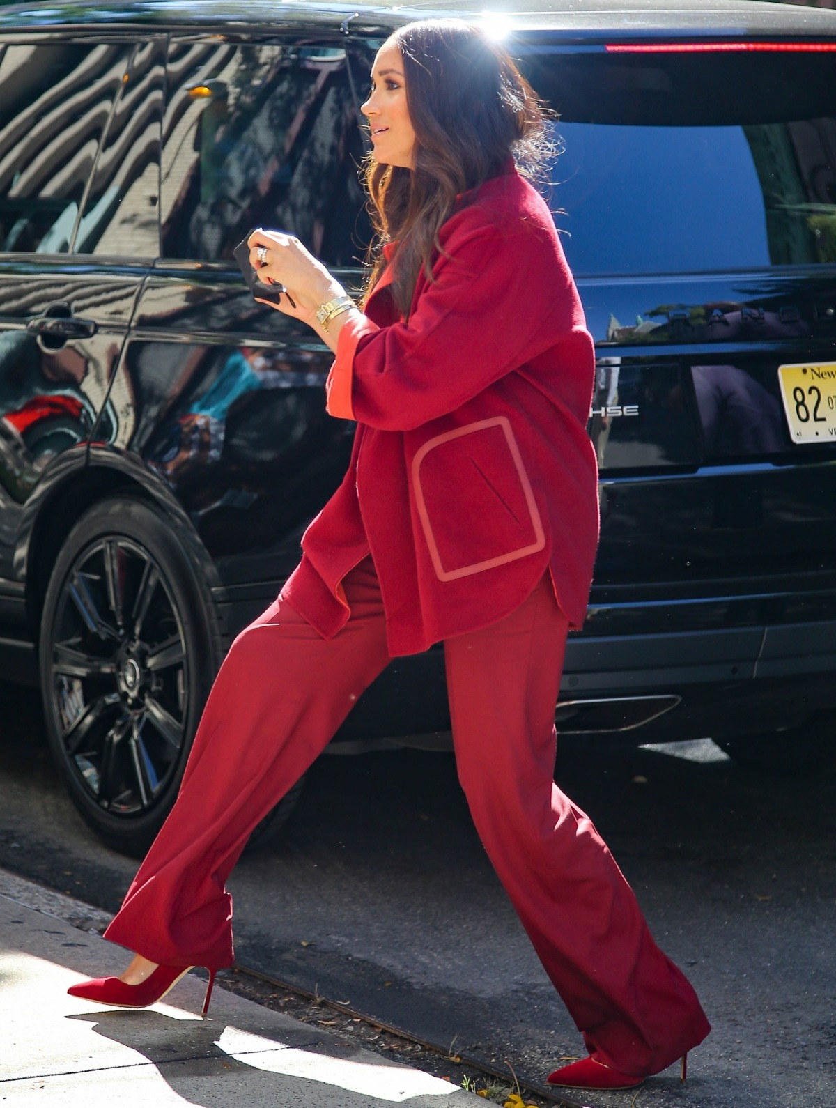 Meghan Markle looks stylish in a red velvet suit as she arrives at a Harlem elementary school