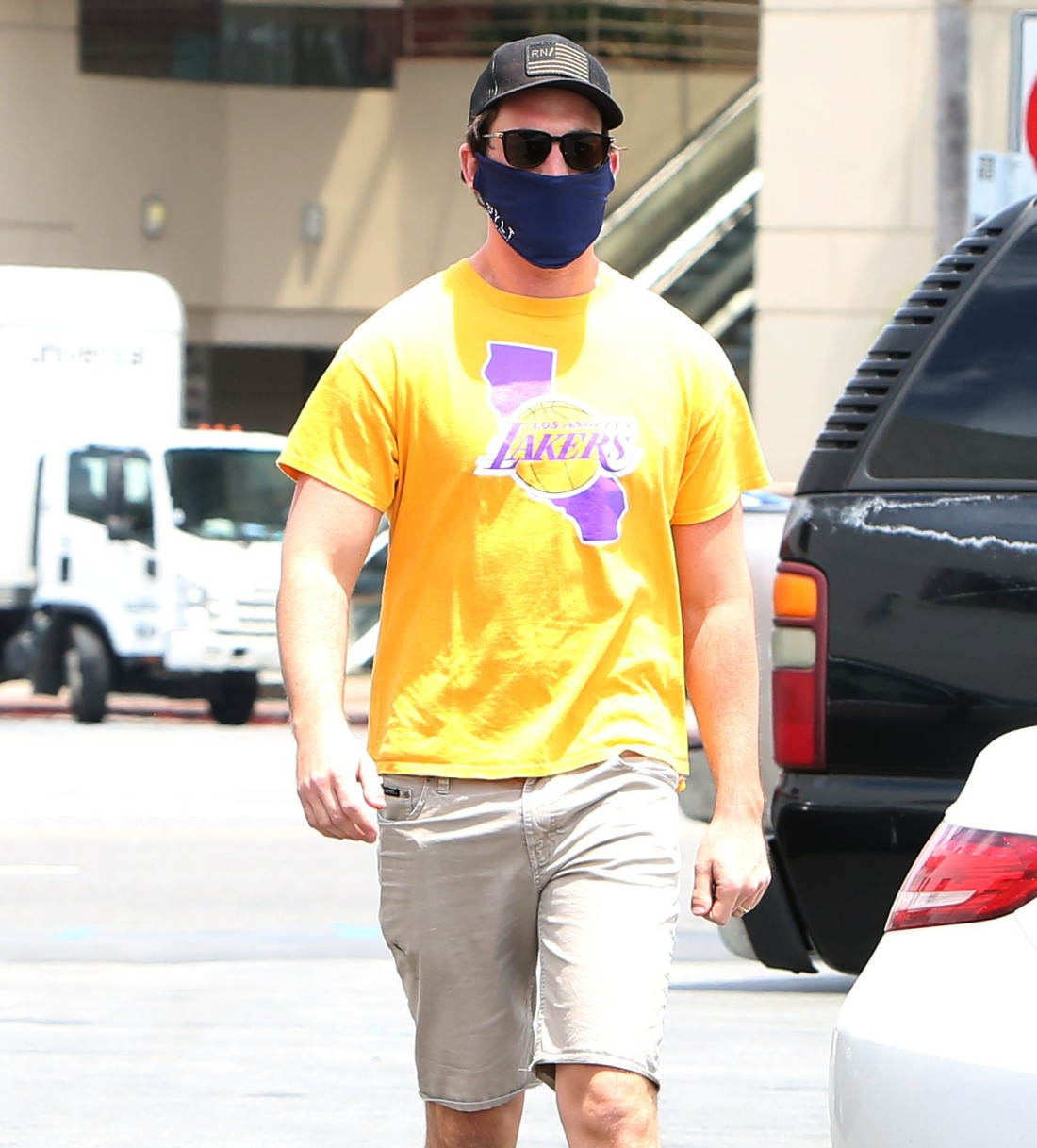 Miles Teller pops out to CVS wearing a Lakers Kobe tee