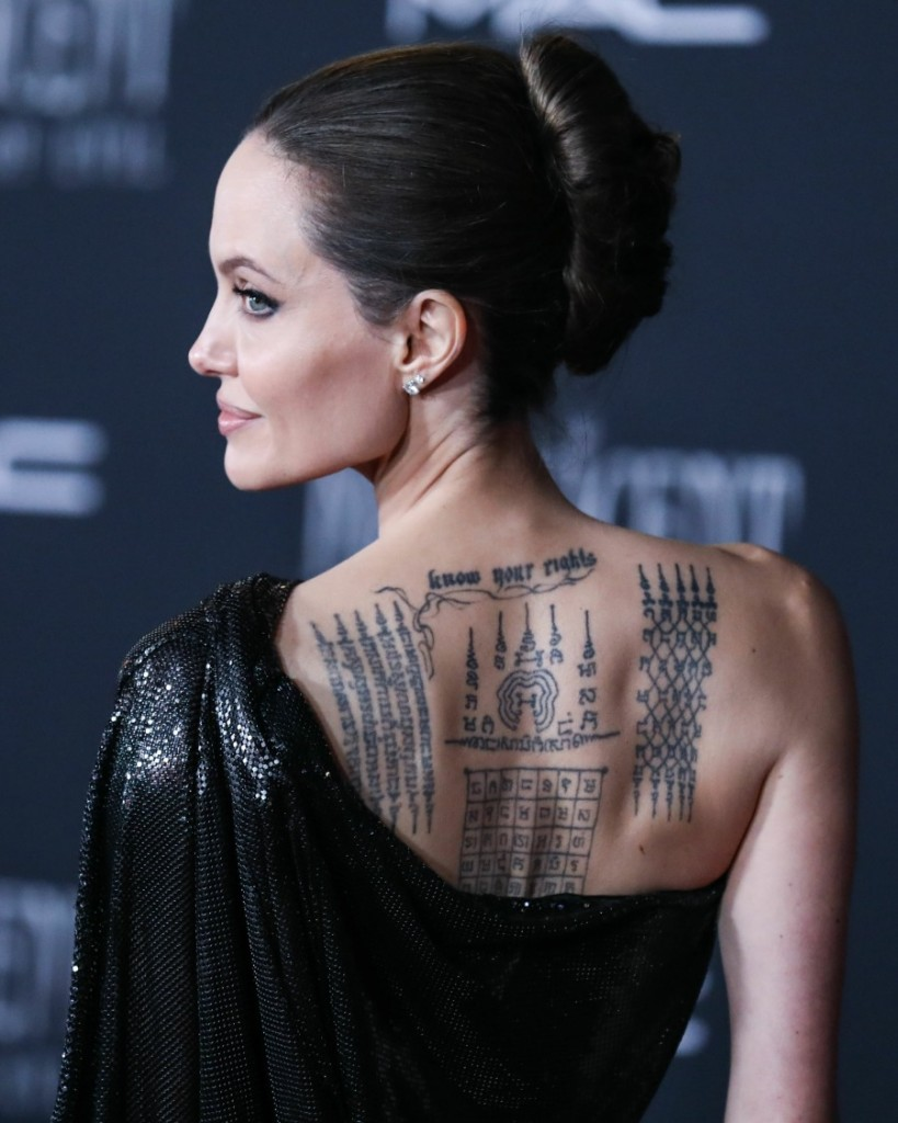 Actress Angelina Jolie wearing Atelier Versace with Cartier jewelry arrives at the World Premiere Of Disney's 'Maleficent: Mistress Of Evil' held at the El Capitan Theatre on September 30, 2019 in Hollywood, Los Angeles, California, United States.