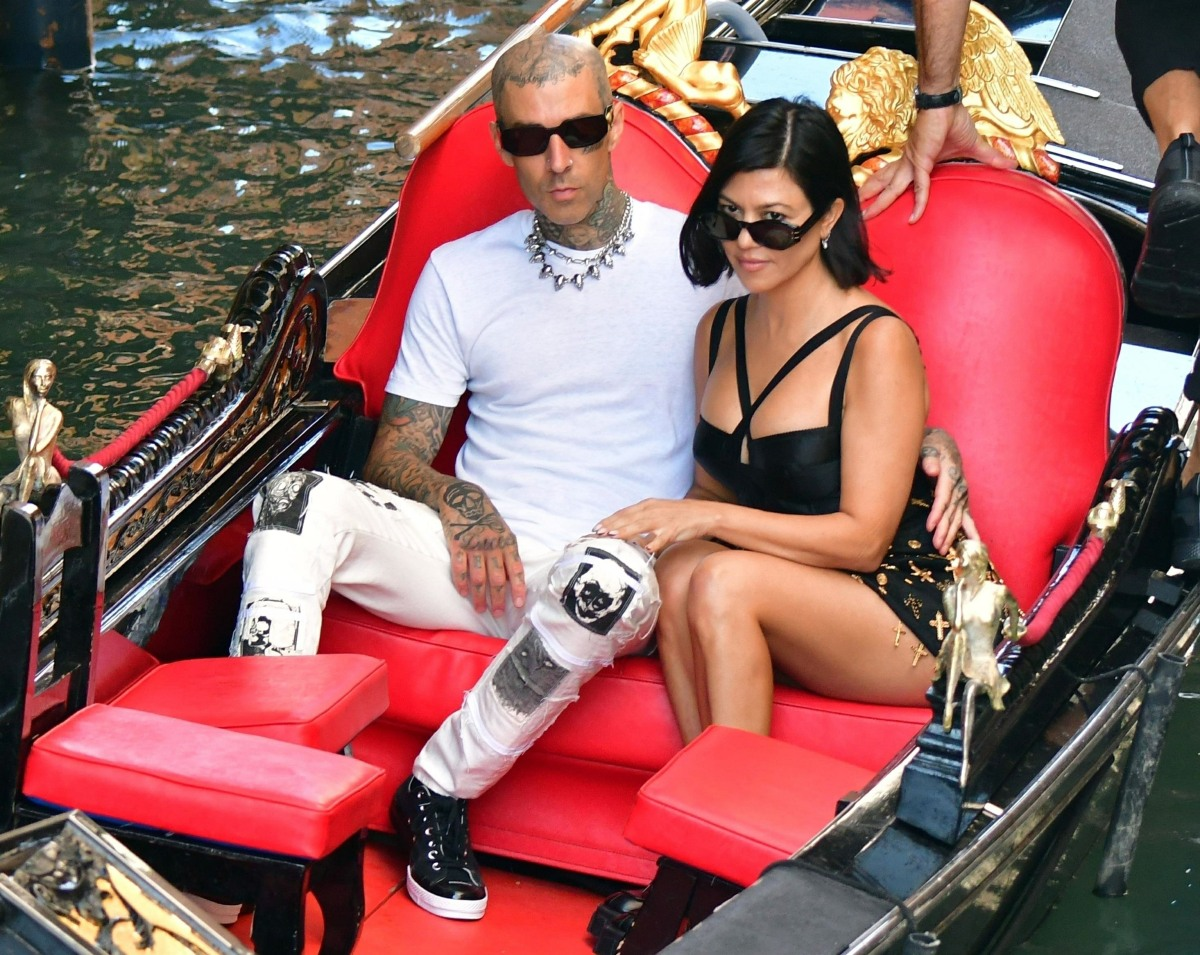Kourtney Kardashian and Travis Barker share a passionate kiss during their gondola ride in Venice