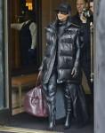 Kim Kardashian wears a Balenciaga leather vest while exiting the Ritz-Carlton Hotel