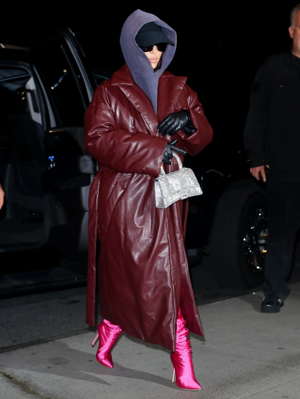 Kim Kardashian switches up her look with a leather coat and hoodie after SNL rehearsals in NYC