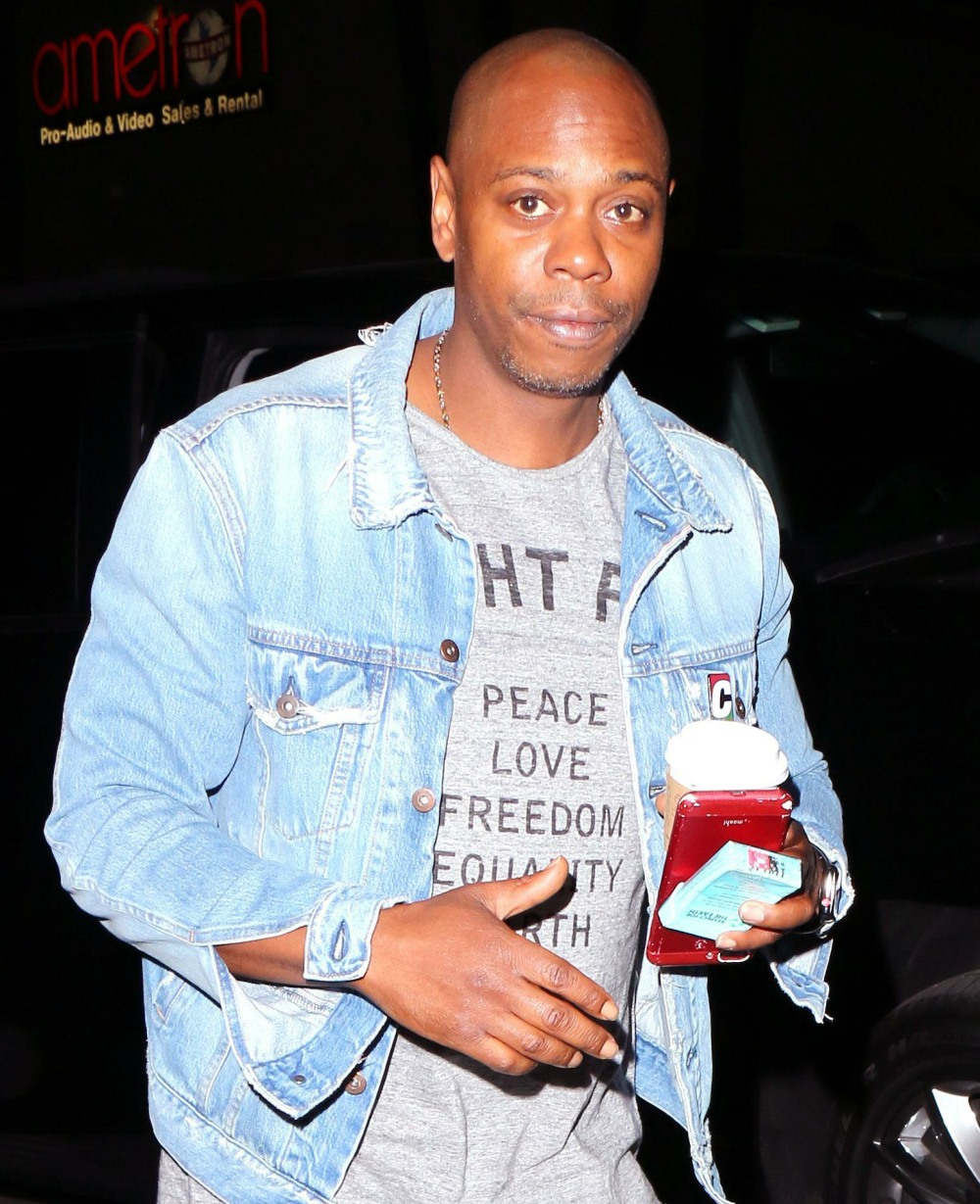 Dave Chappelle wearing denim on denim with plenty of holes and carrying a pack of smokes as he arrives for his performance at The Hollywood Palladium